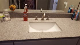 Custom Keystone cultured marble vanity top with undermount porcelain bowl