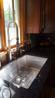 Nice large single bowl sink with industrial faucet takes care of ALL of your needs!